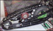 Натяжной ролик гусеницы — это два колесика от самоката.