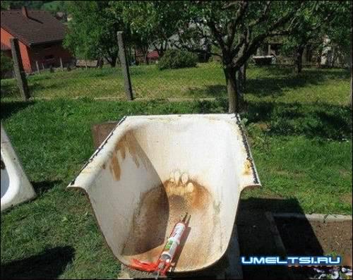 Разрезаем болгаркой ванну